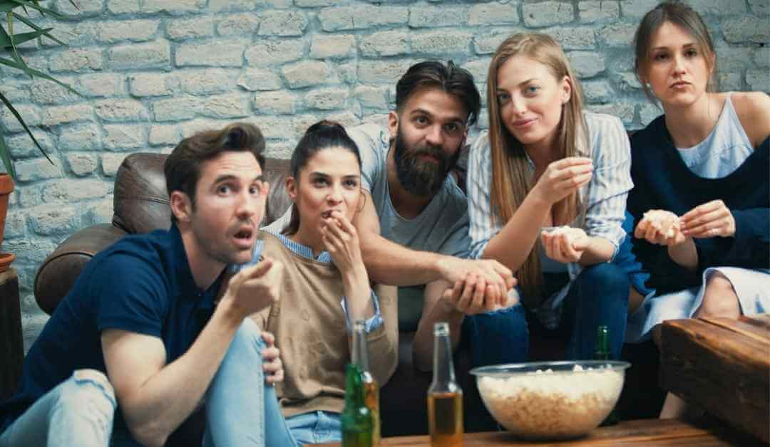 Group of students watching movie together